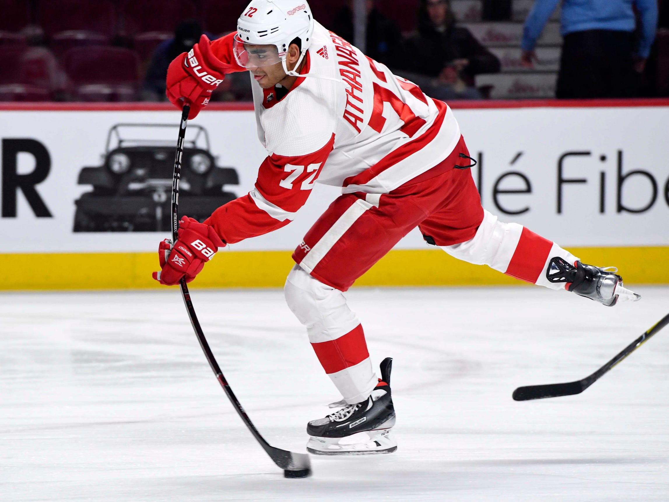 Detroit Red Wings forward Andreas Athanasiou shoots a puck during warmups before the game against the Montreal Canadiens at the Bell Centre, March 12, 2019 in Montreal.