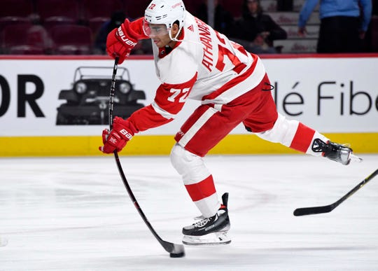 Andreas Athanasiou shoots a puck during warmups before the game against Montreal at the Bell Centre on Tuesday.