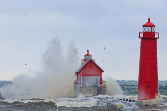 Large waves from Lake Michigan batter the Grand Haven South Pier and Lighthouse in Grand Haven.