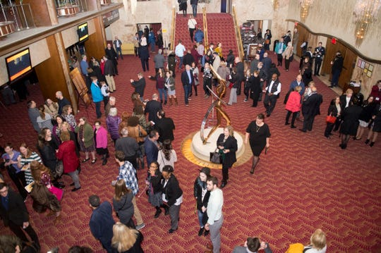 "Theatregoers paced the lobby of the Fisher Theatre before Tuesday's night's premiere of ""Hamilton."""