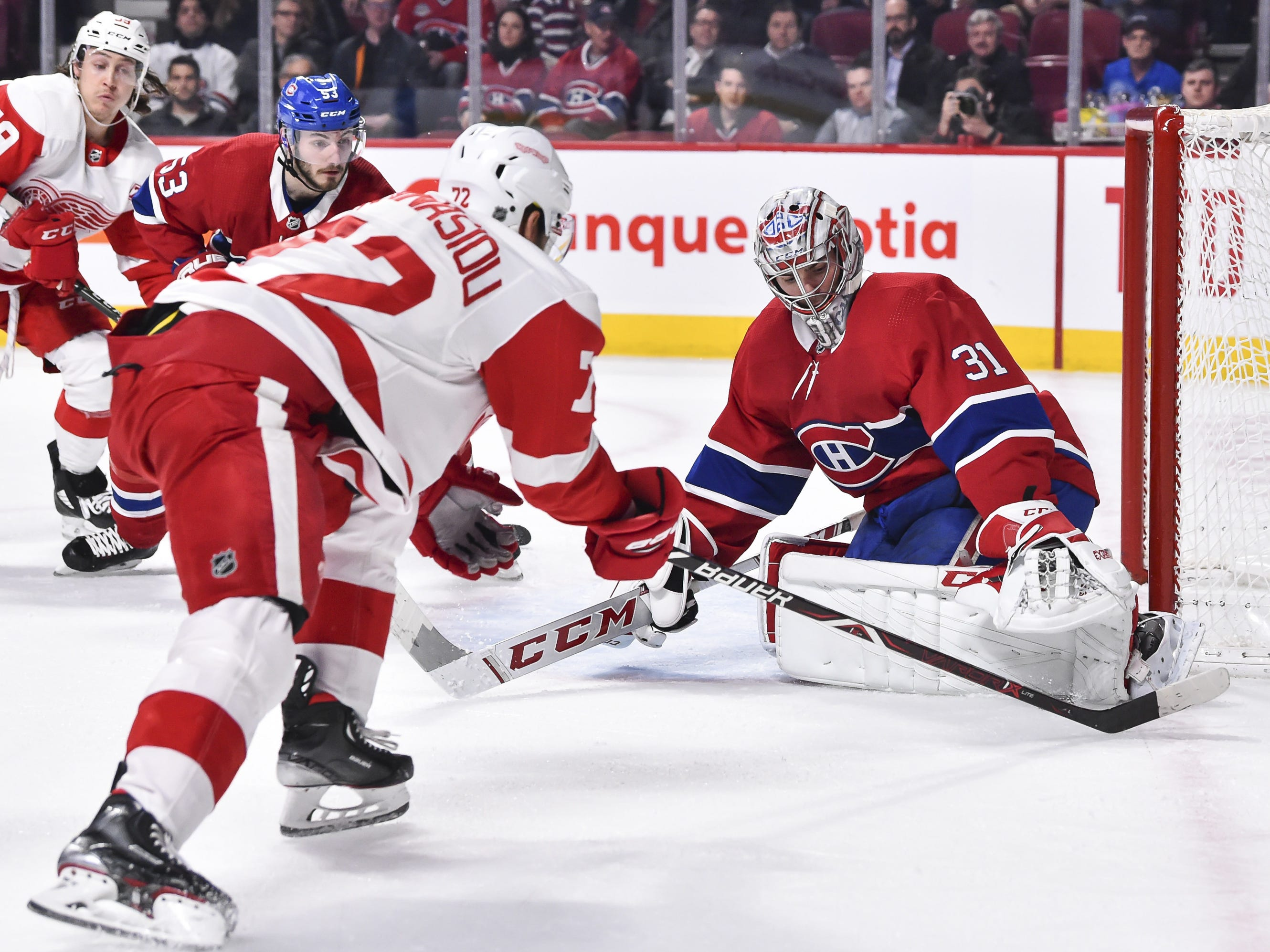Goaltender Carey Price of the Montreal Canadiens makes a pad save on Andreas Athanasiou of the Detroit Red Wings at the Bell Centre on March 12, 2019 in Montreal.