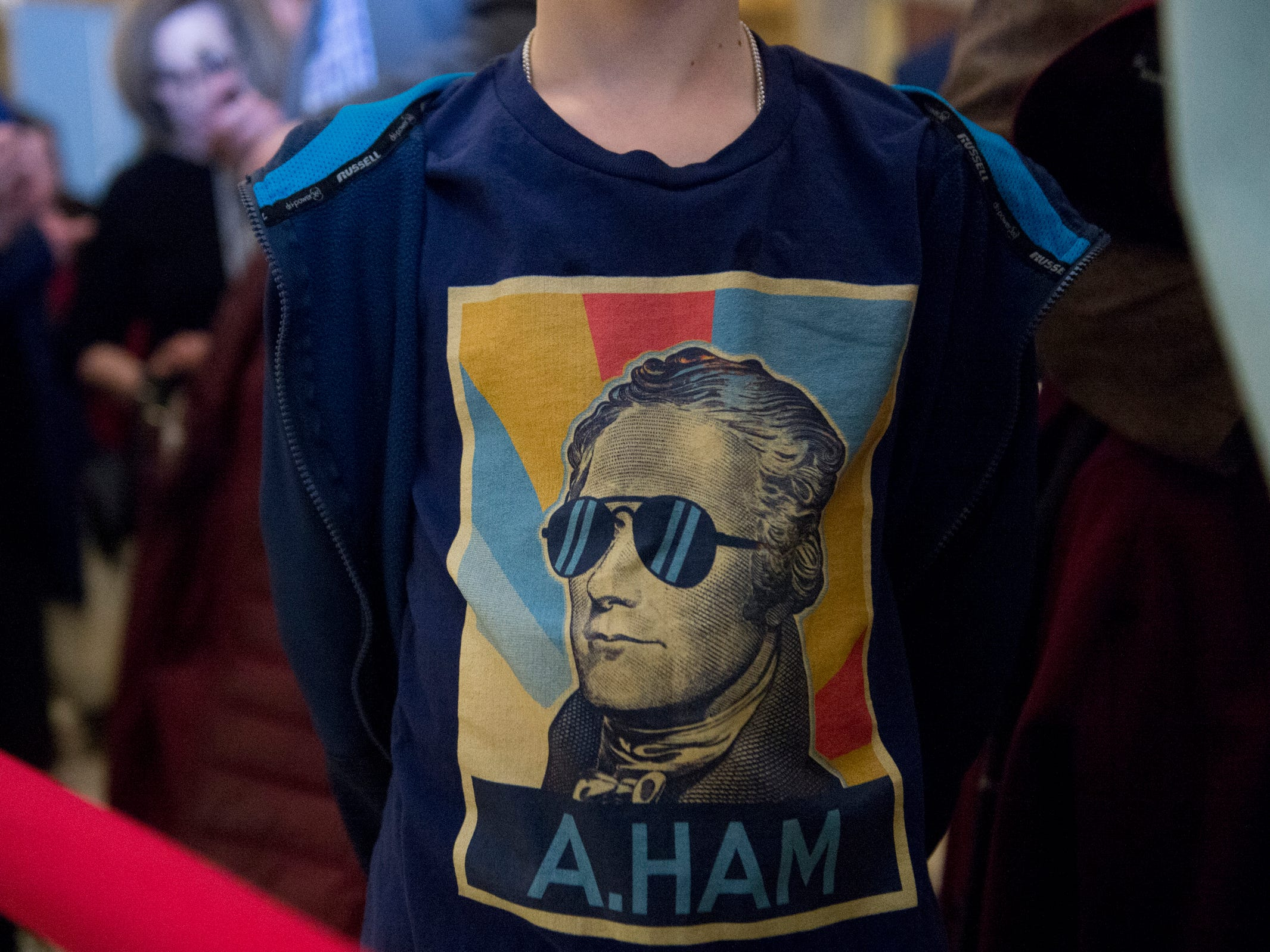 Ben Ruprecht, 12, of Rochester Hills wears a Hamilton t-shirt while waiting to enter the Fisher Theatre for the play's opening on Tuesday, March 12, 2019 in Detroit. The opening night of Broadway's Hamilton played to a full house in Detroit on Tuesday.