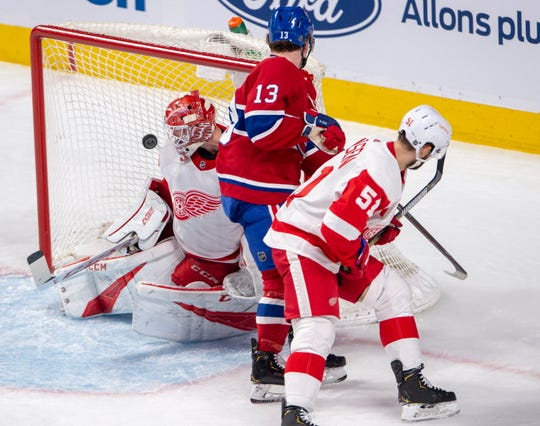 Canadiens center Max Domi (13) scores against Red Wings goaltender Jonathan Bernier, as Frans Nielsen defends during the second period Tuesday in Montreal.