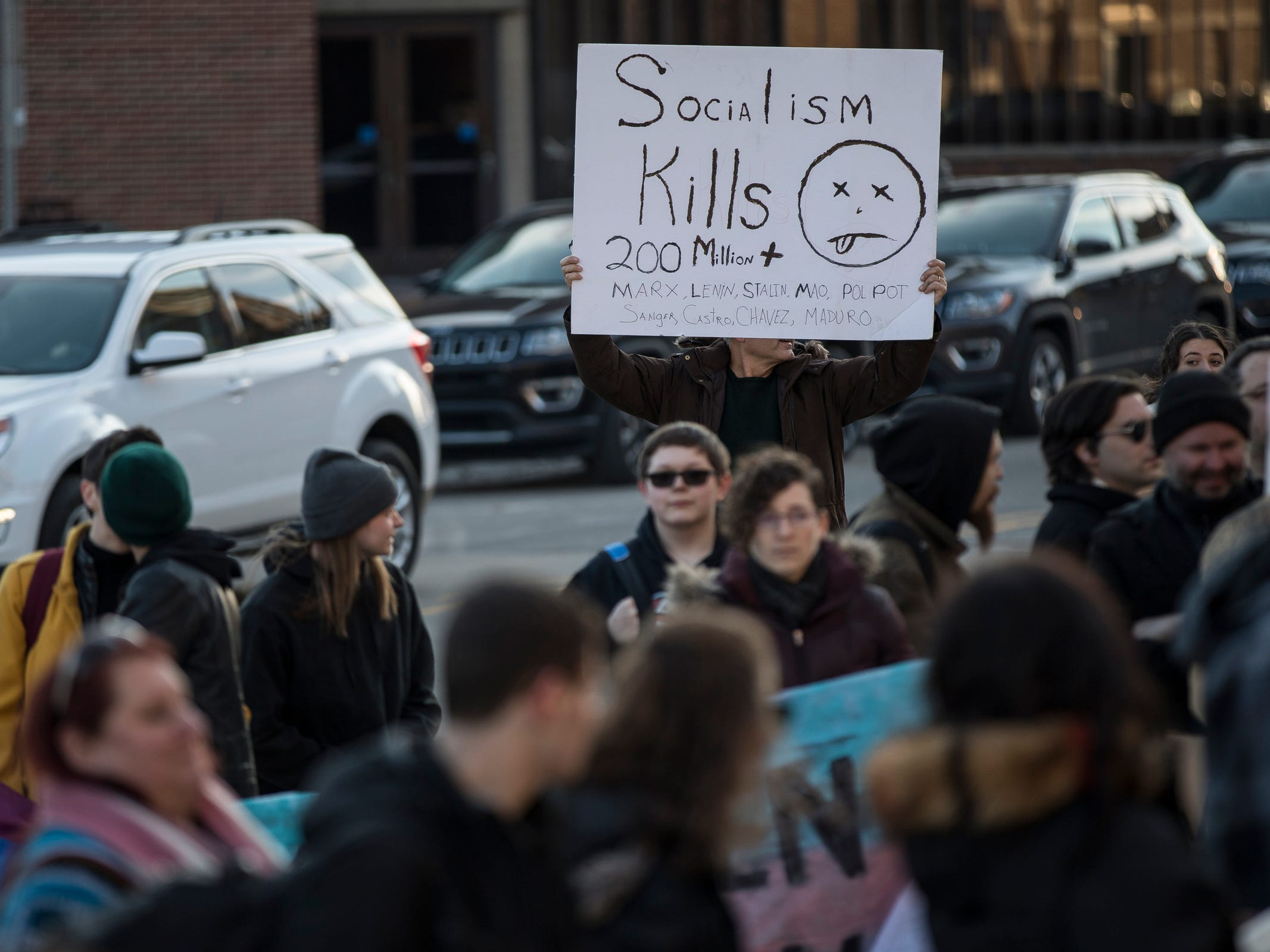Protesters and counter protesters protest outside of the Rackham Auditorium on U-M central campus in Ann Arbor as attendees enter the building for Ben Shapiro's speech, Tuesday, March 12. , Tuesday, March 12, 2019.