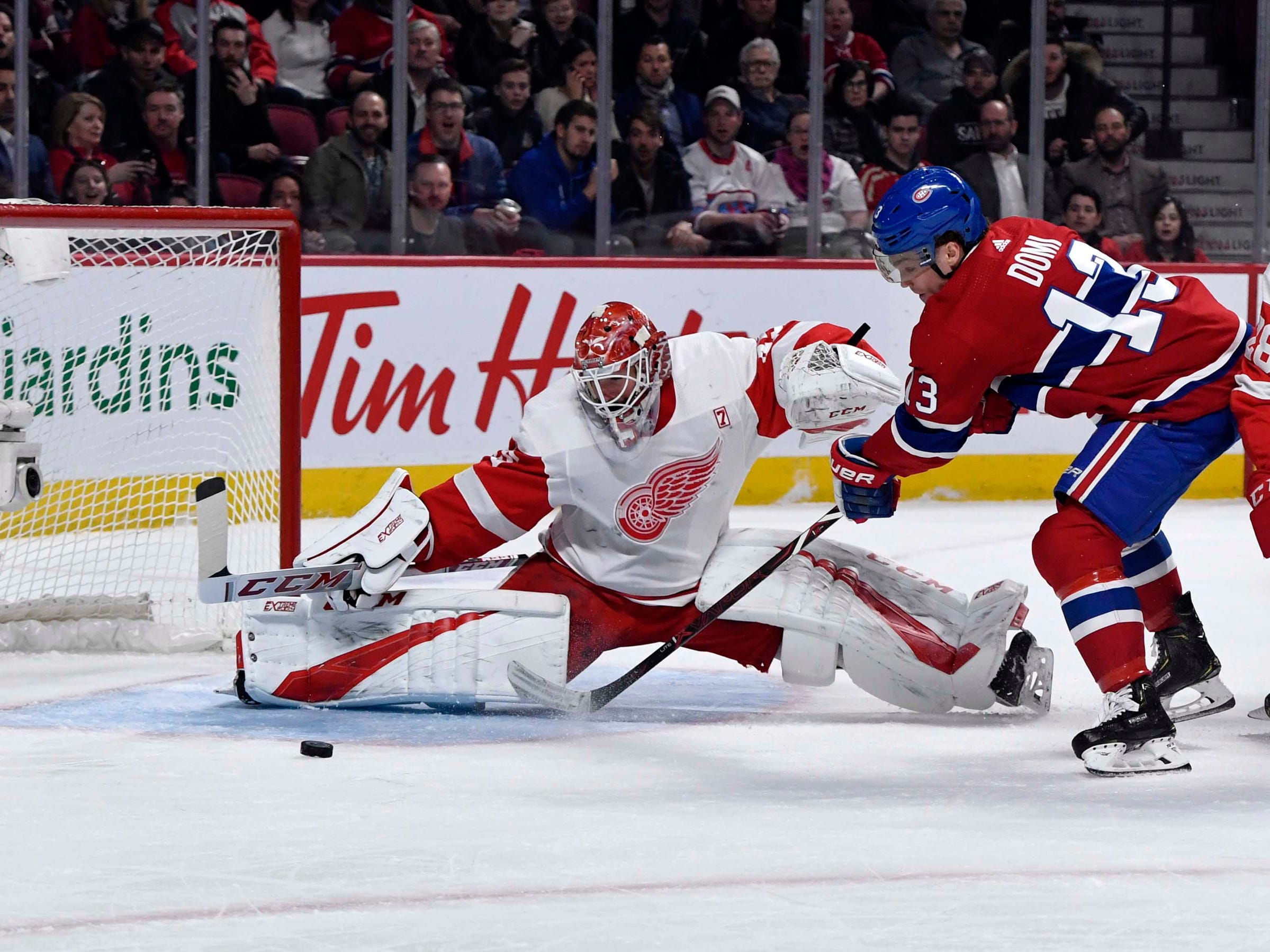 Detroit Red Wings goalie Jonathan Bernier stops Montreal Canadiens forward Max Domi during the first period at the Bell Centre, March 12, 2019 in Montreal.