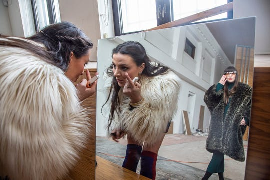 Terese Reyes, left, and Bridget Finn, prepare for a photo shoot Monday, March 4, 2019 in their new Reyes Finn gallery space on Trumbull Avenue in Corktown.