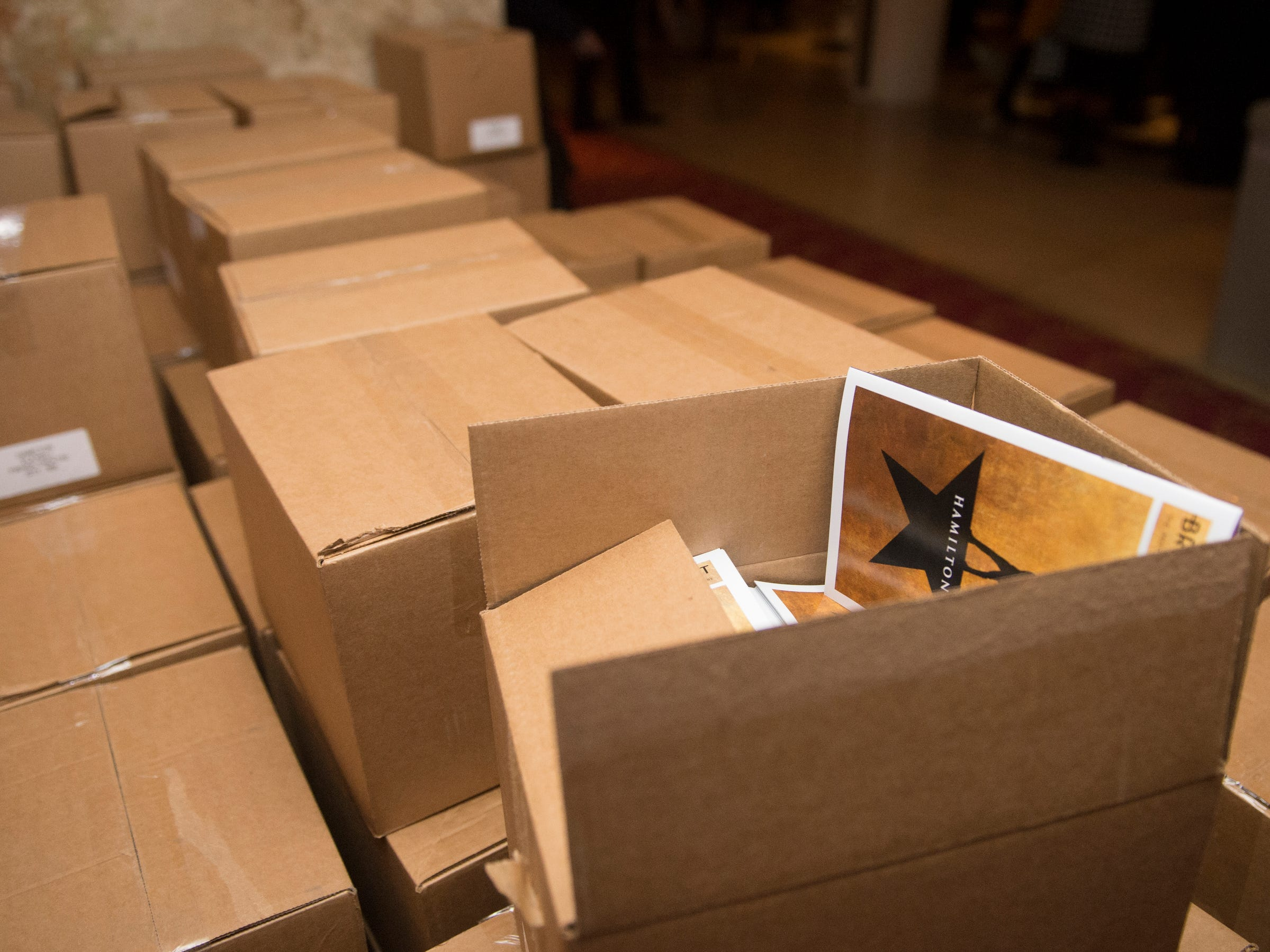 A pallet's worth of Hamilton programs sit in the lobby of the Fisher Theatre on Tuesday, March 12, 2019. The opening night of Broadway's Hamilton played to a full house in Detroit on Tuesday.