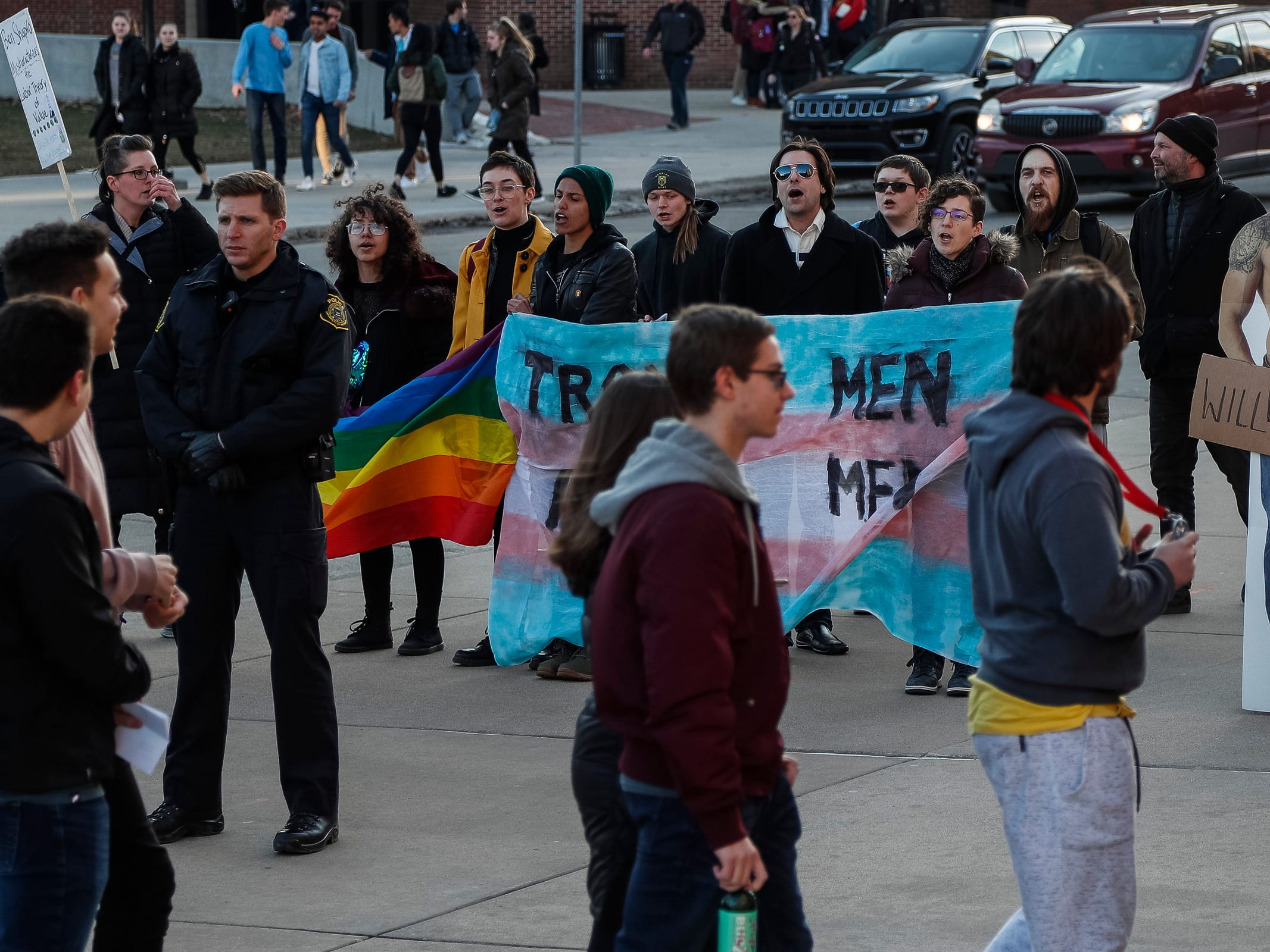 Protesters protest outside of the Rackham Auditorium on U-M central campus in Ann Arbor as attendees enter the building for Ben Shapiro's speech, Tuesday, March 12. , Tuesday, March 12, 2019.