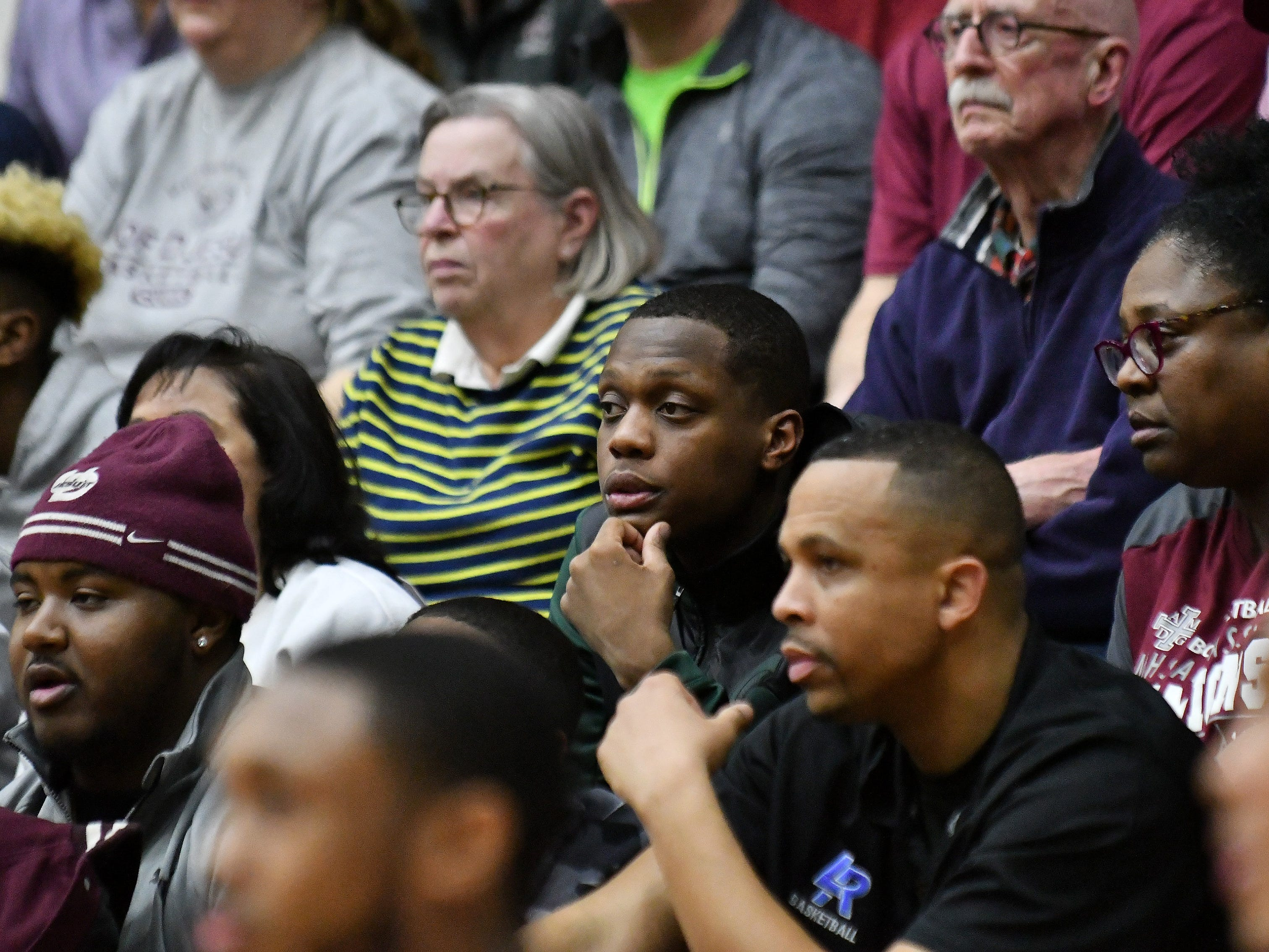 Michigan State guard Cassius Winston, center, was in the audience watching his brother, Khy Winston, play for U-D Jesuit in the second half.