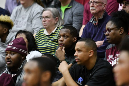 Michigan State guard Cassius Winston, center, was in the audience watching his brother, Khy Winston, play for U-D Jesuit in the second half of a recent playoff game.