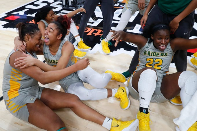 Wright State center Tyler Frierson, from left, guard Anisja Harris and Teneshia Dixon (22) celebrate their 55-52 victory over Green Bay during an NCAA women's basketball game in the Horizon League conference tournament championship in Detroit, Tuesday, March 12, 2019. .