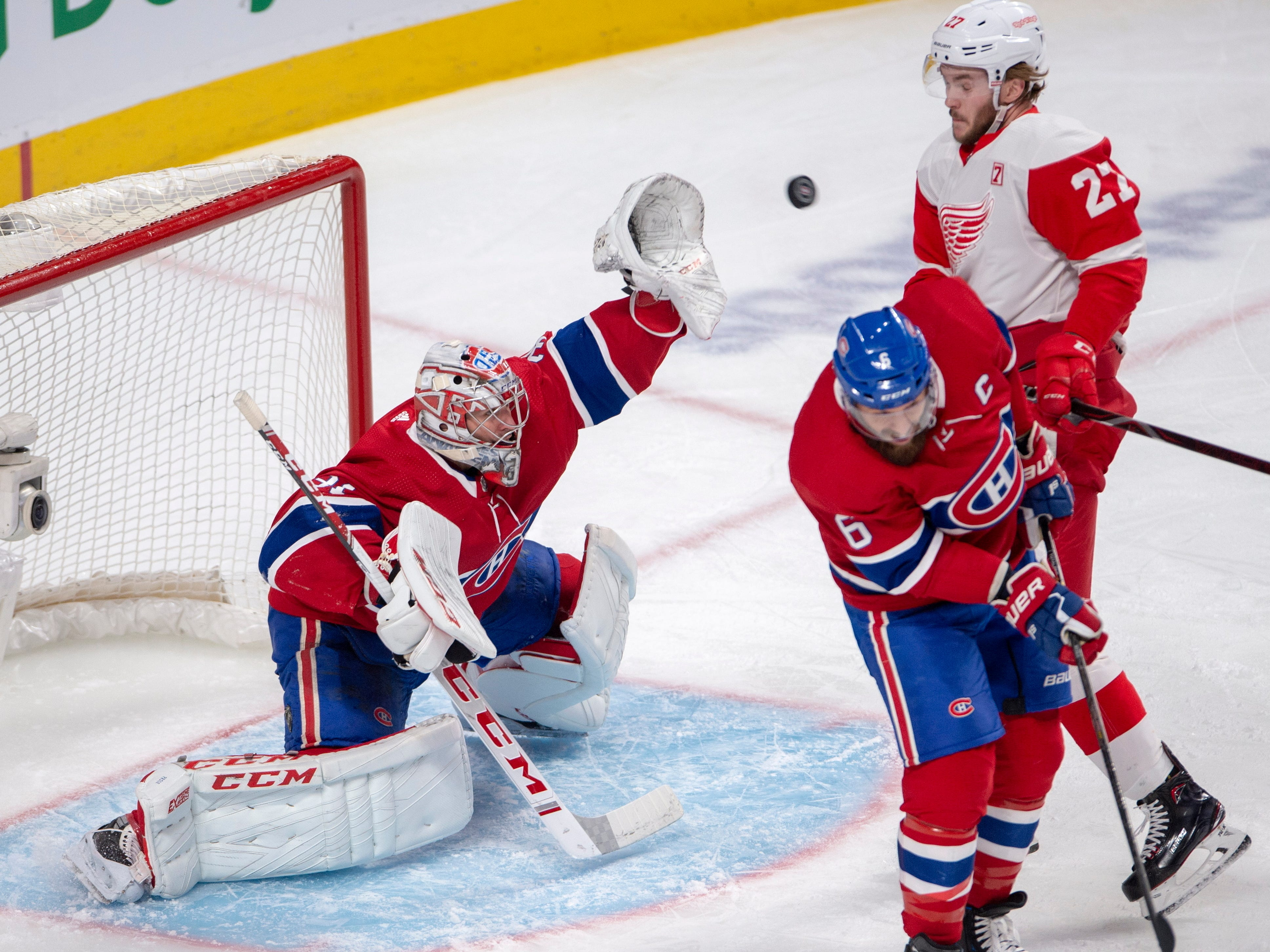 Montreal Canadiens goaltender Carey Price (31) makes a save as Detroit Red Wings center Michael Rasmussen (27) and Montreal Canadiens defenseman Shea Weber (6) watch during the second period.