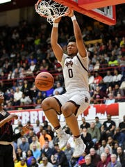U-D Jesuit's Daniel Friday dunks in the first half against Roseville in Division 1 quarterfinals at Calihan Hall in Detroit on March 12, 2019.