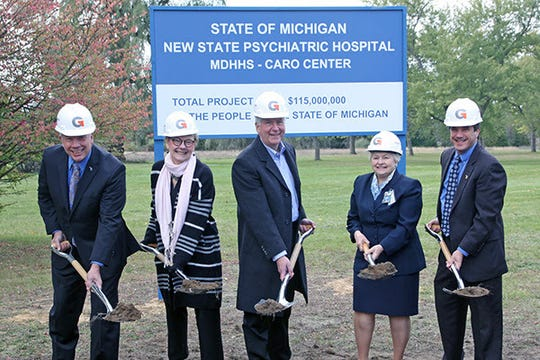 Shown during a 2018 ceremonial groundbreaking ceremony at the site of the new Caro Psychiatric Hospital are, from left, Michigan Department of Technology, Management and Budget Director David DeVries; Cynthia Kelly, director of the MDHHS Bureau of Hospitals and Administrative Operations for Behavioral Health and Developmental Disabilities; Gov. Rick Snyder; Caro Center Director Rose Laskowski; and MDHHS Director Nick Lyon.