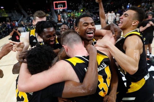 Northern Kentucky players celebrate their 77-66 win against Wright State for the Horizon League championship in March.
