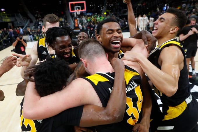 Northern Kentucky players celebrate their 77-66 win against Wright State in an NCAA college basketball game for the Horizon League men's tournament championship in Detroit, Tuesday, March 12, 2019.