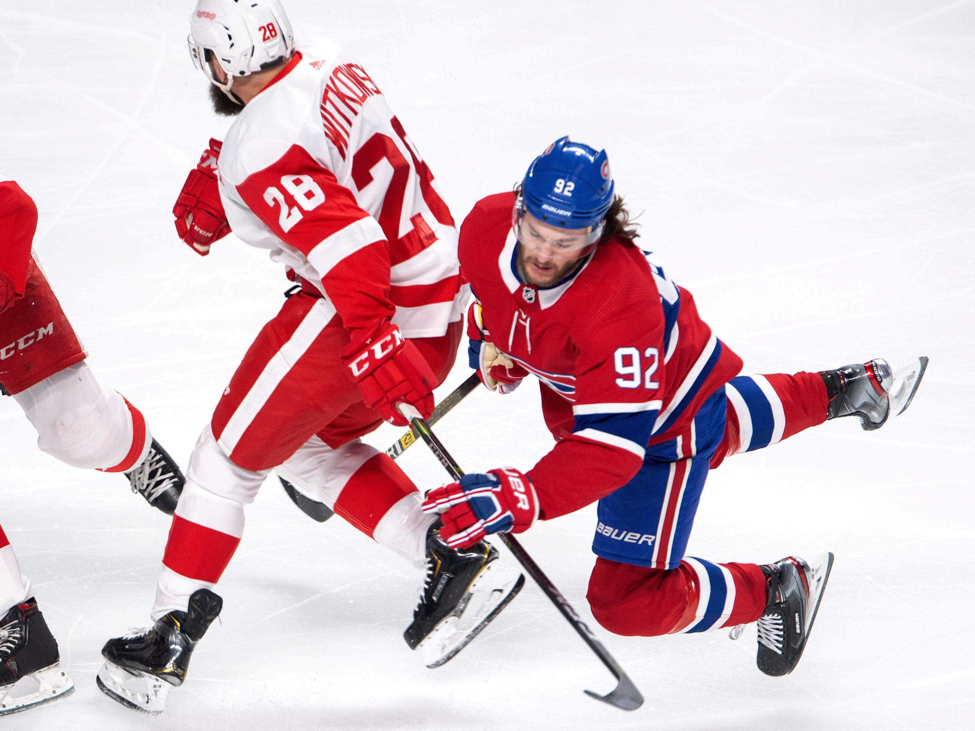 Montreal Canadiens left wing Jonathan Drouin (92) is upended by Detroit Red Wings right wing Luke Witkowski (28) during the first period.