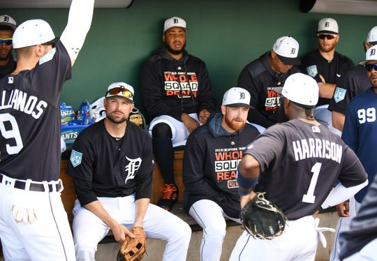Tigers second baseman Josh Harrison talks to teammates, including Jordy Mercer (seated left), earlier this spring.