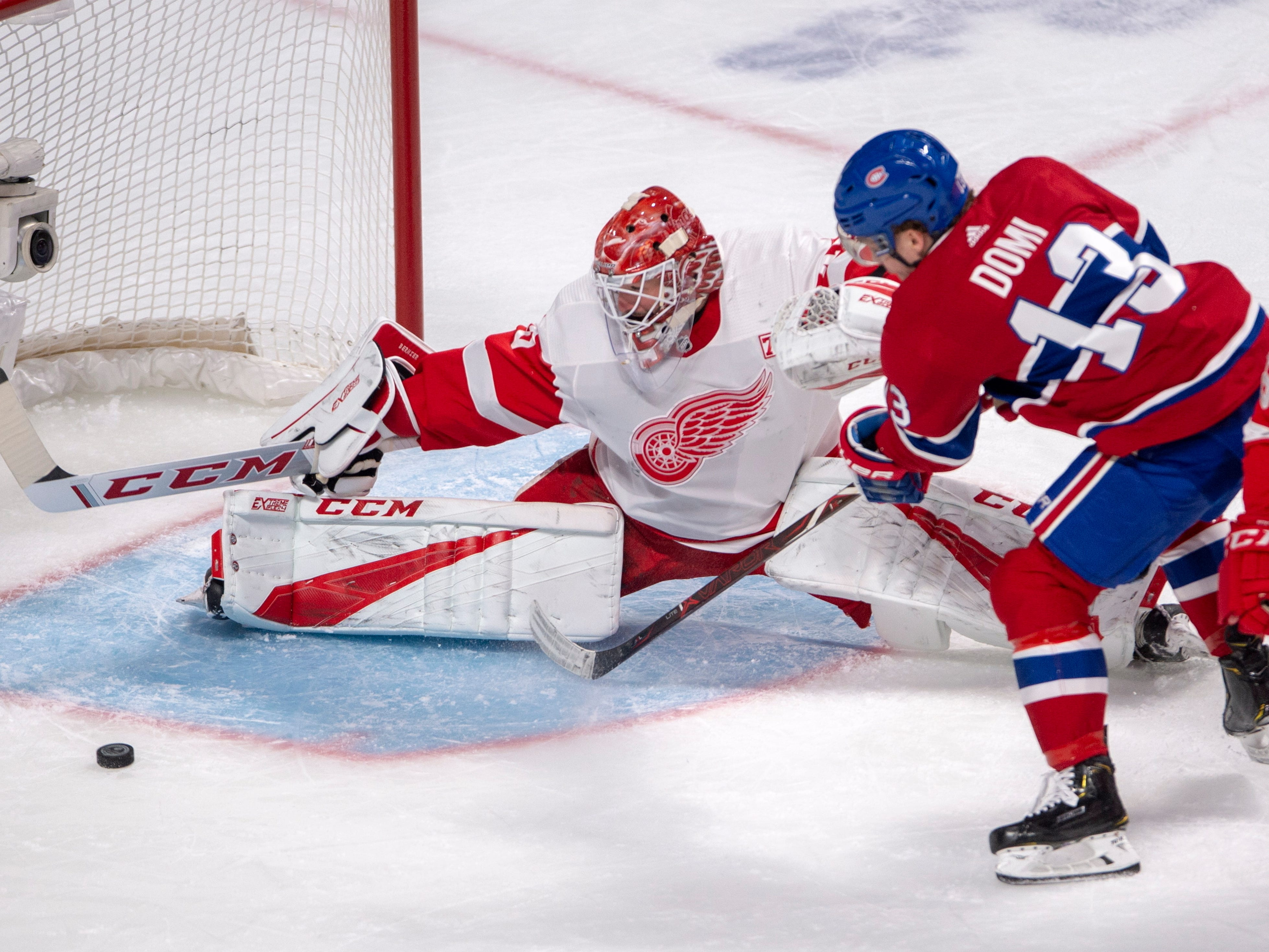 Montreal Canadiens center Max Domi (13) shoots wide on Detroit Red Wings goaltender Jonathan Bernier (45) during the first period.