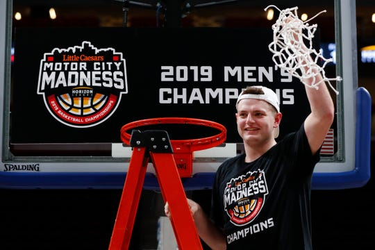 Northern Kentucky's Drew McDonald holds up the net after winning the Horizon League championship Tuesday night.