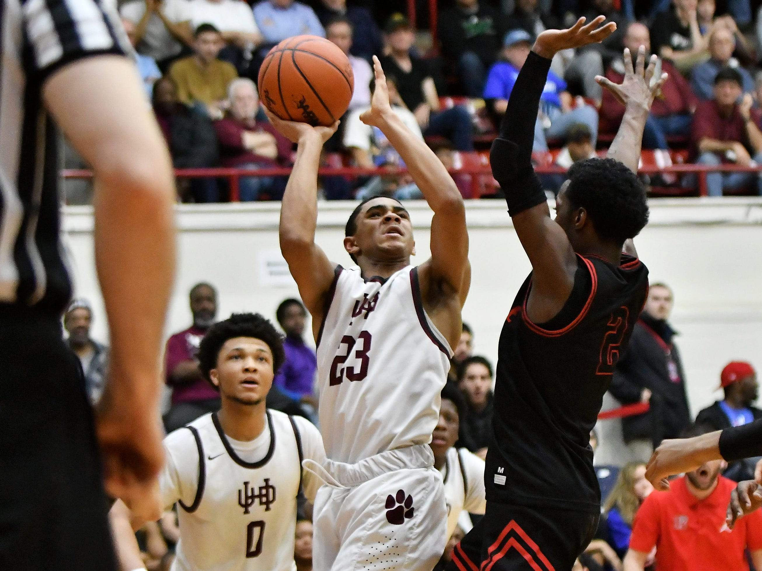 Roseville's Martell Turner (2) guards U-D Jesuit's JonMarcus Roland (23) in the first half.