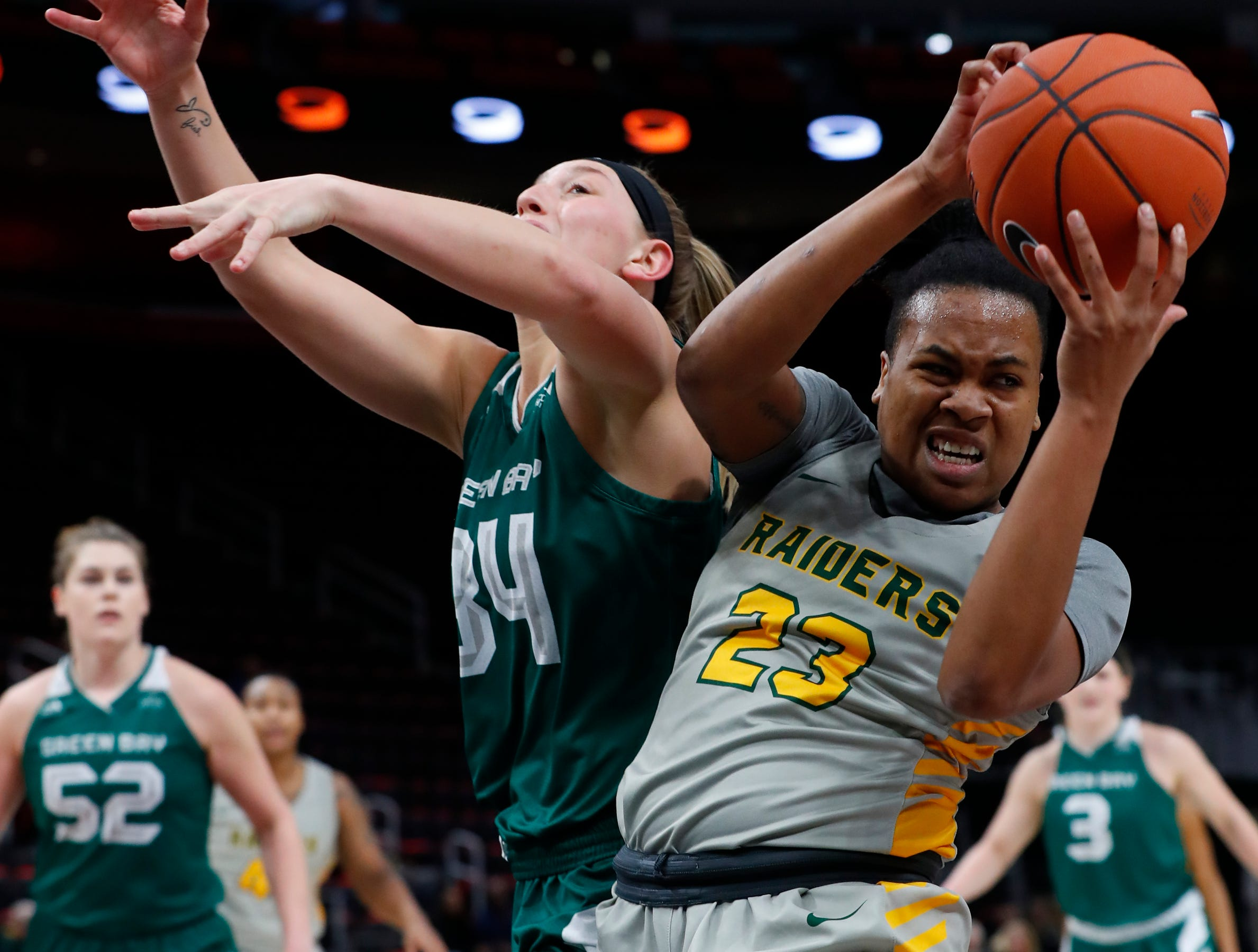 Wright State guard Symone Simmons (23) pulls down a rebound from Green Bay forward Carly Mohns (34) in the first half.