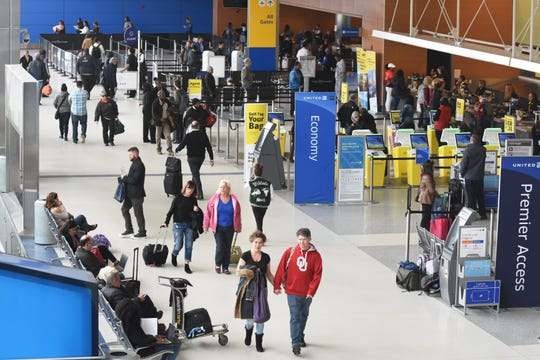 Travelers check in at United Airlines for their flights at Detroit Metro Airport's North Terminal Wednesday afternoon. Only Southwest, American and Air Canada airlines fly Boeing 737 Max 8/9 airplanes from Detroit.