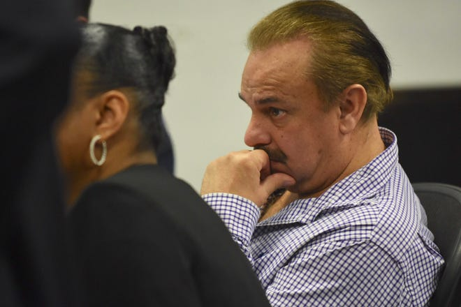 Robert Carmack listens to witness testimony at 36 District Court on Wednesday, March 13, 2019.