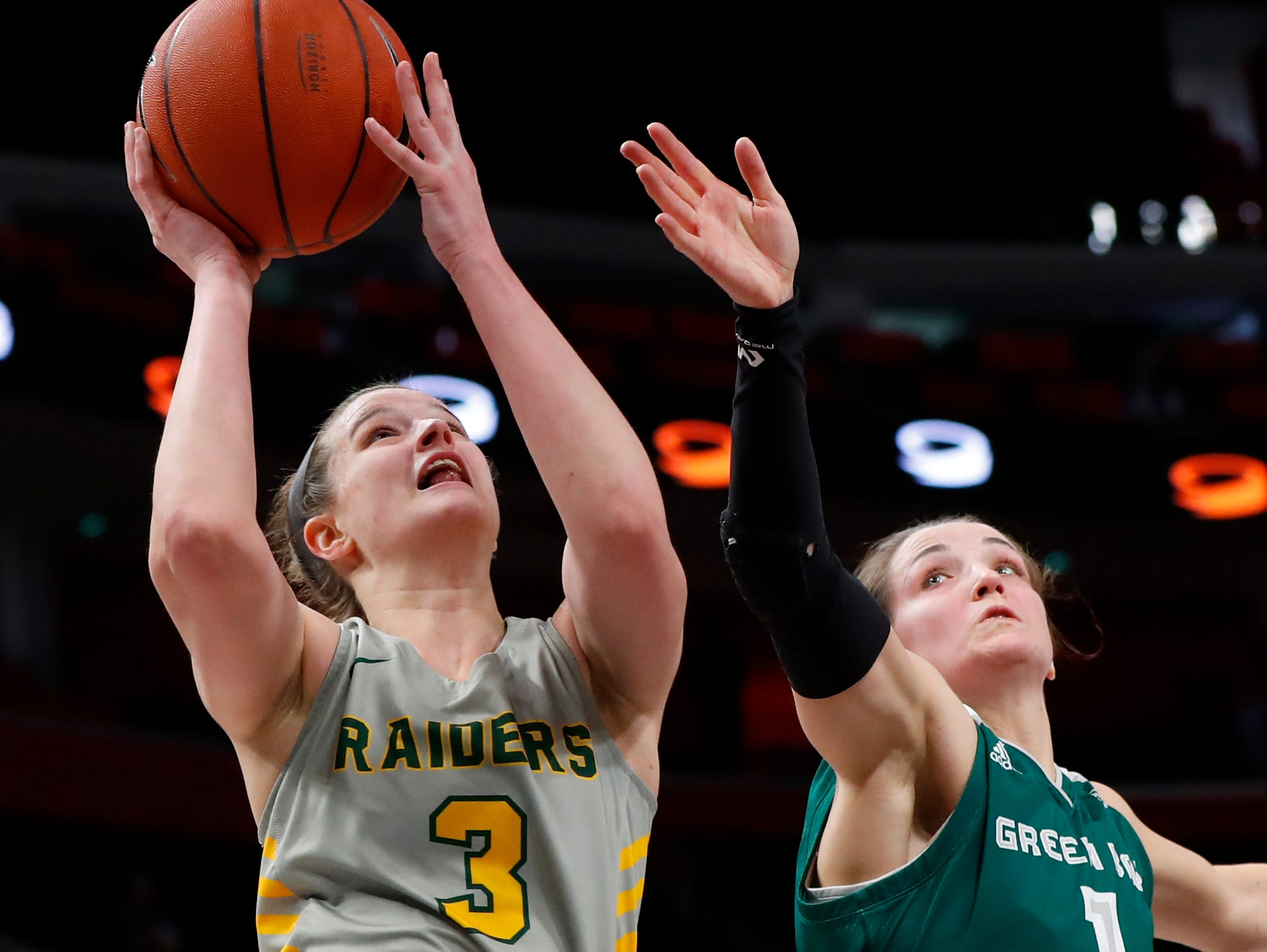 Wright State guard Emily Vogelpohl (3) shoots on Green Bay guard Jen Wellnitz (1) in the first half.