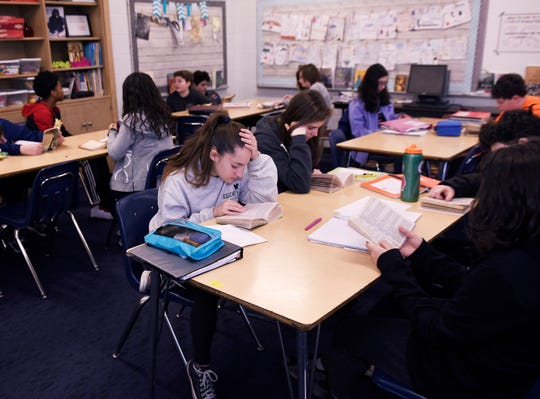 Eighth graders do their reading assignment during teacher Shana Ramin's language and literature class at Norup Middle School in Oak Park.