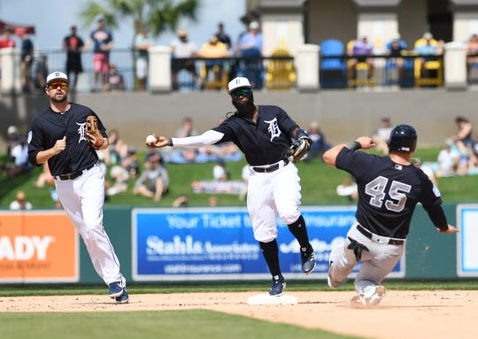 Tigers second baseman Josh Harrison touches second in front of shortstop Jordy Mercer last month.