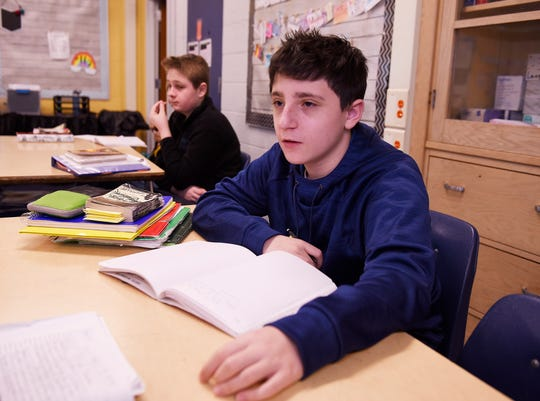 Eighth grader Morgan Klein, 14, discusses the English lesson during language and literature class at Norup Middle School in Oak Park.