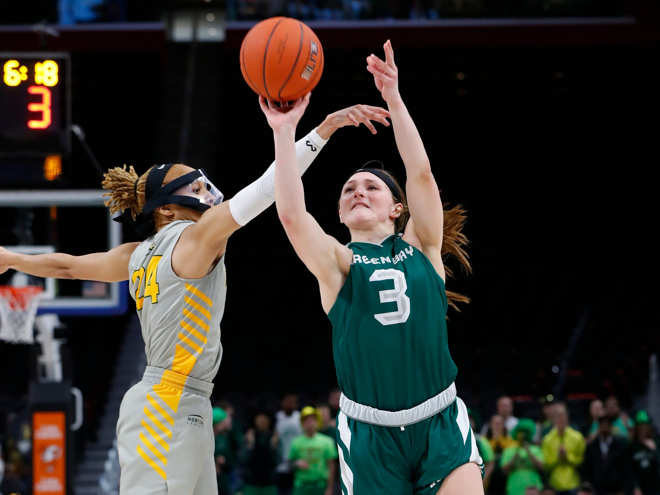 Green Bay guard Frankie Wurtz (3) shoots as Wright State guard Michal Miller (24) defends.