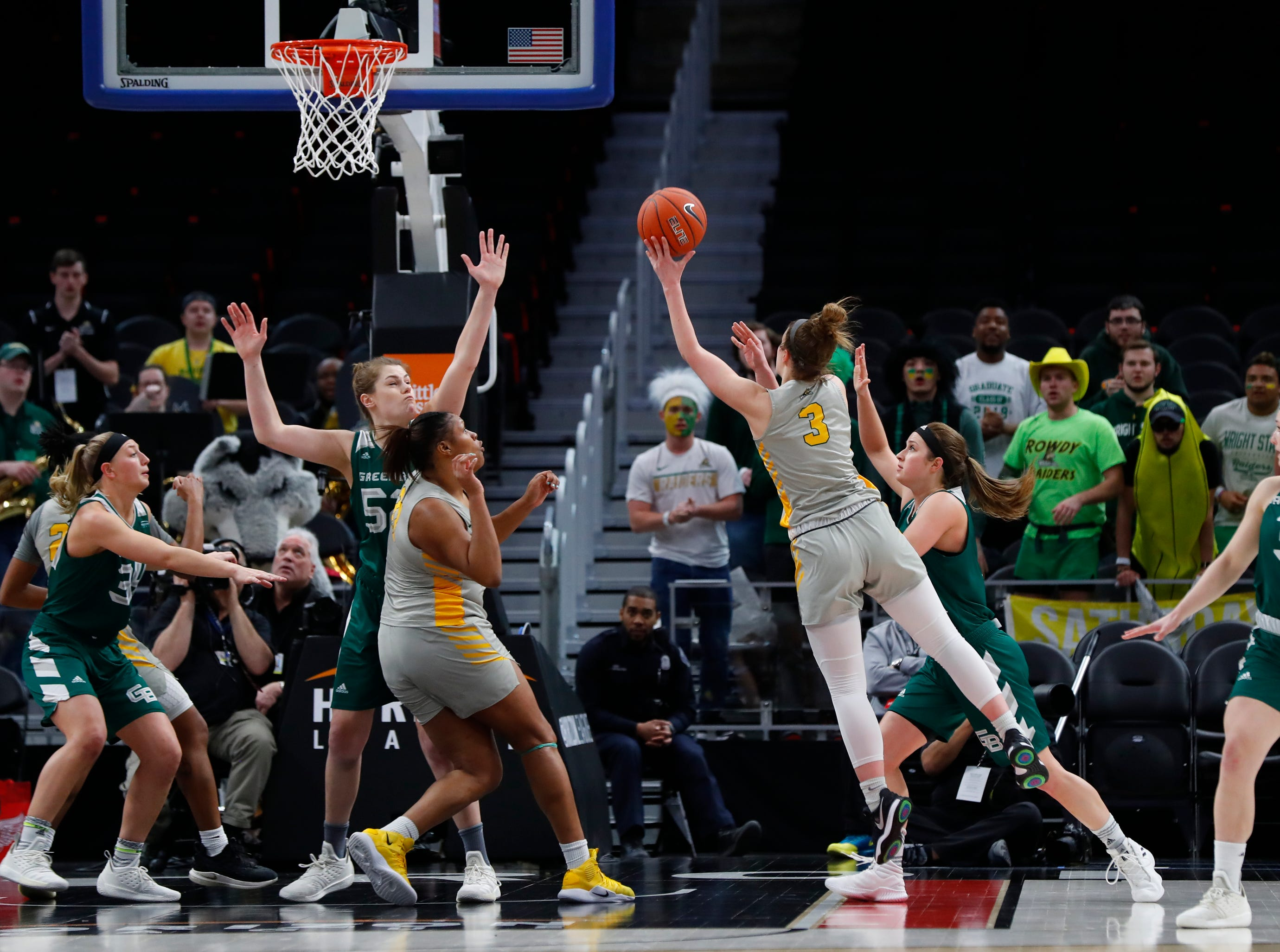 Wright State guard Emily Vogelpohl (3) drives to the basket against the Green Bay in the second half.
