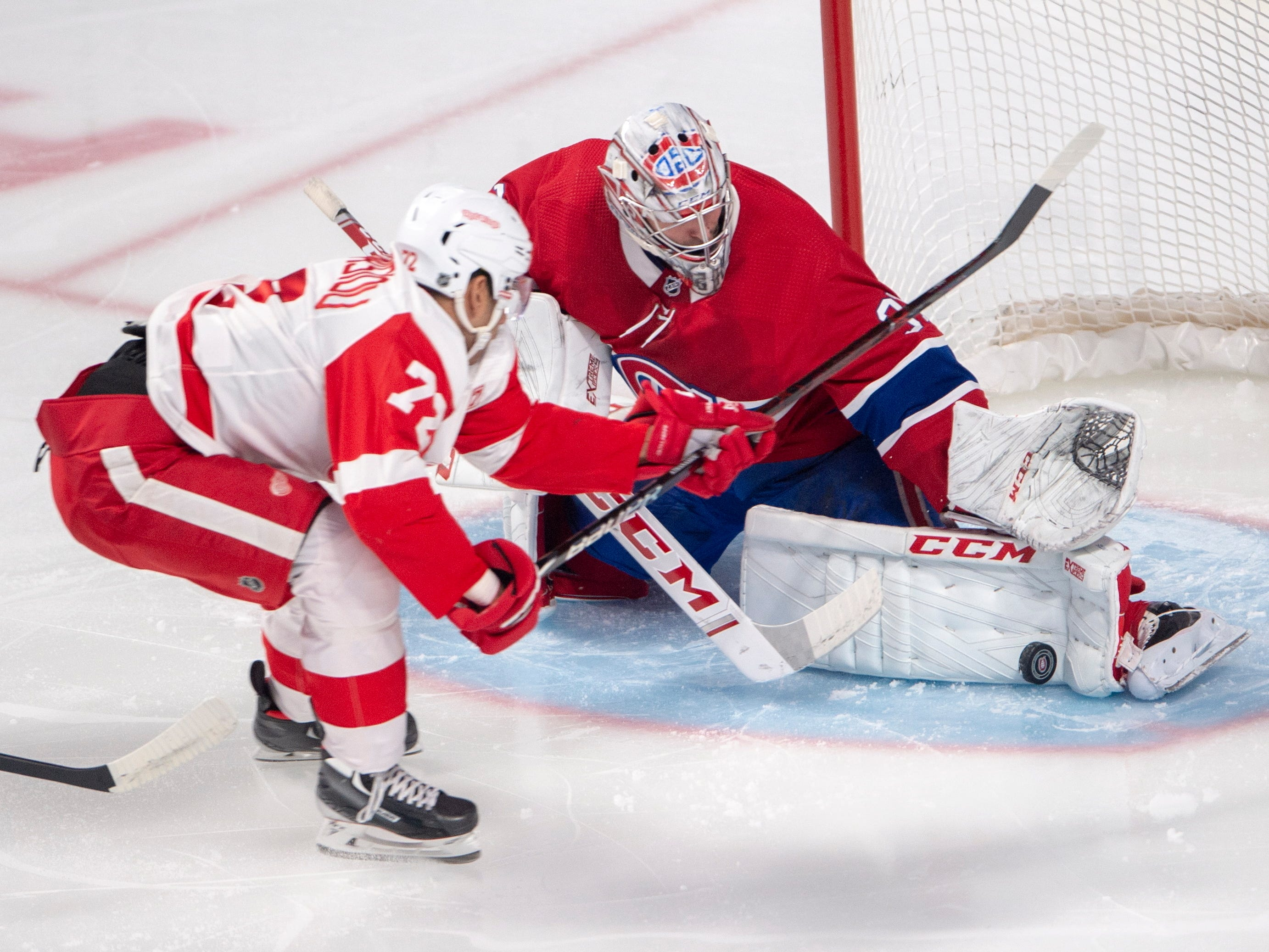 Montreal Canadiens goaltender Carey Price (31) makes the save on Detroit Red Wings centre Andreas Athanasiou (72) during the first period on Tuesday, March 12, 2019, in Montreal.