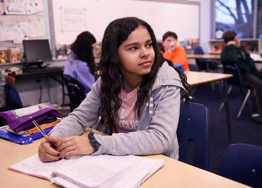 Olivia White, 13, listens to the lesson during 8th grade language and literature class class at Norup Middle School in Oak Park.