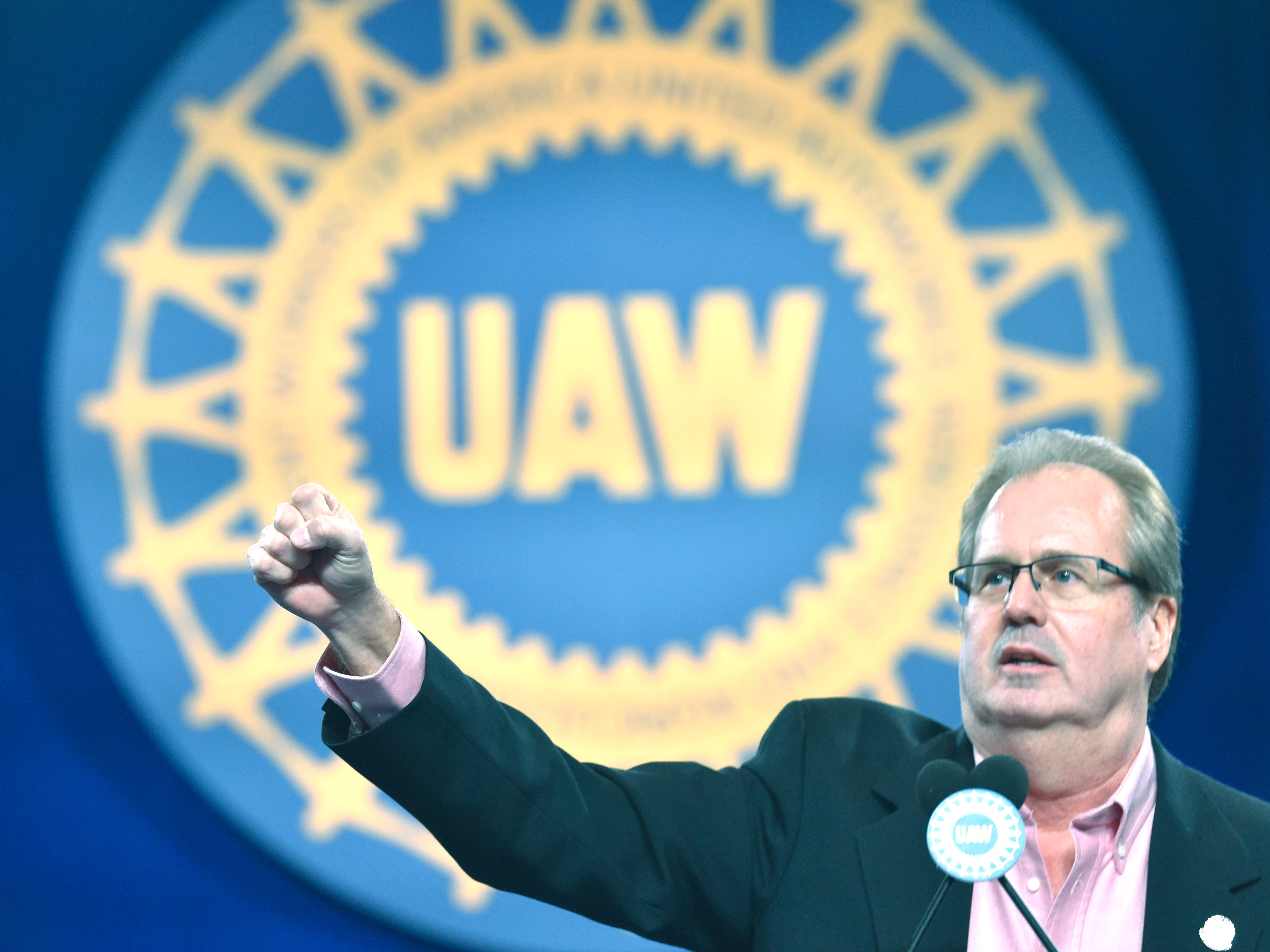 UAW President Gary Jones fires up delegates as he starts the chant, 'We Are One,' during his keynote speech.