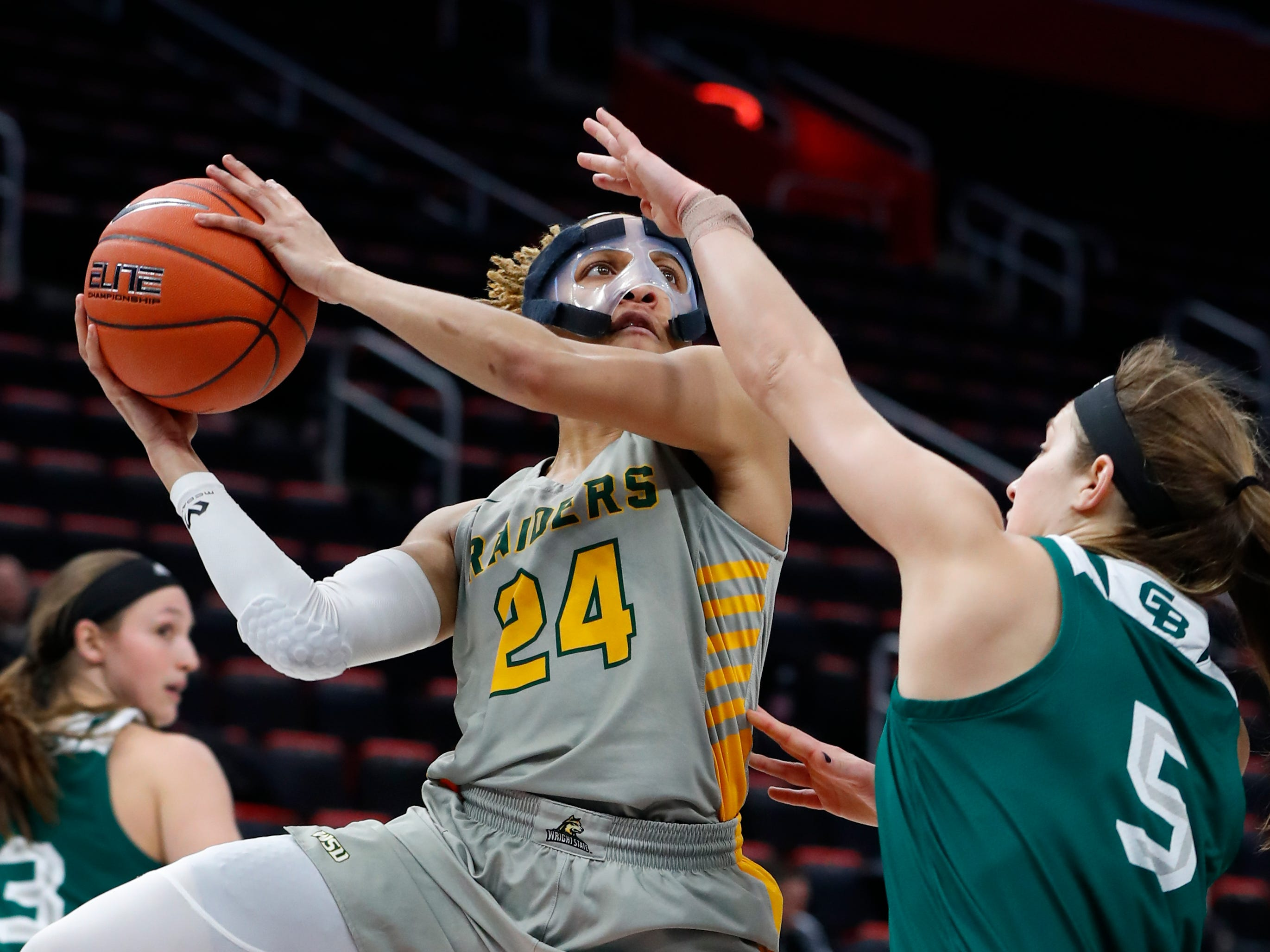 Wright State guard Michal Miller (24) shoots over Green Bay guard Laken James (5) in the first half.