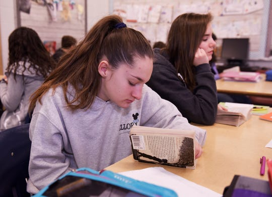 Maddy Pitler, 14, reads her book assignment during 8th grade language and literature class class at Norup Middle School in Royal Oak.