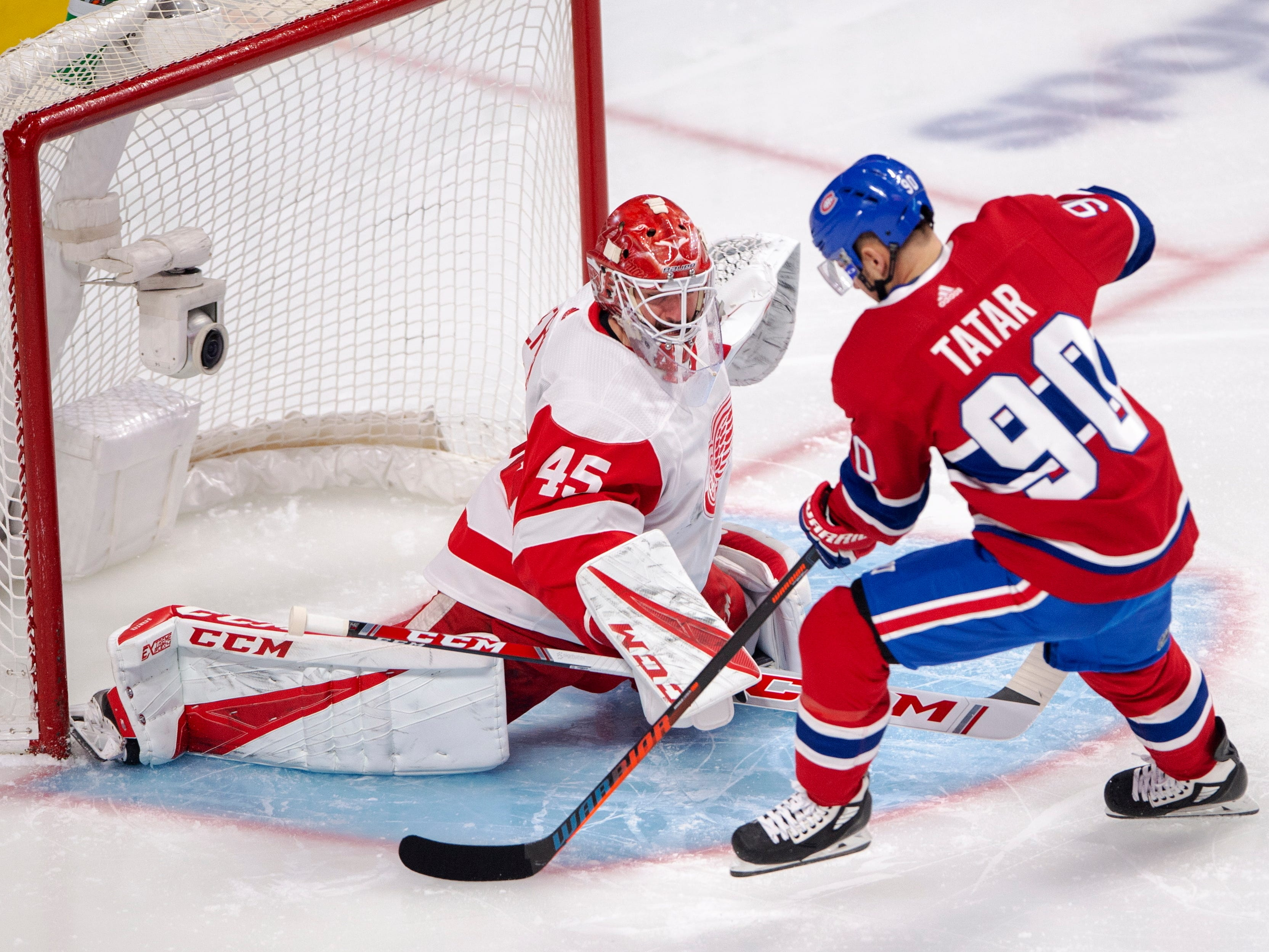 Detroit Red Wings goaltender Jonathan Bernier (45) stops Montreal Canadiens left wing Tomas Tatar (90) during the first period.