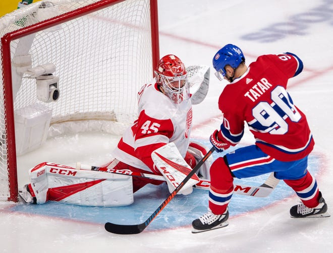 Red Wings goaltender Jonathan Bernier stops Canadiens left wing Tomas Tatar during the first period of Detroit's 3-1 loss in Montreal on March 12, 2019.