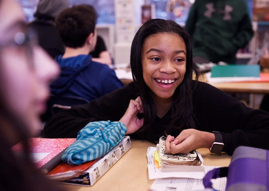 Paris Burk, 12, discusses the reading assignment with team members during English class at Norup Middle School in Oak Park.