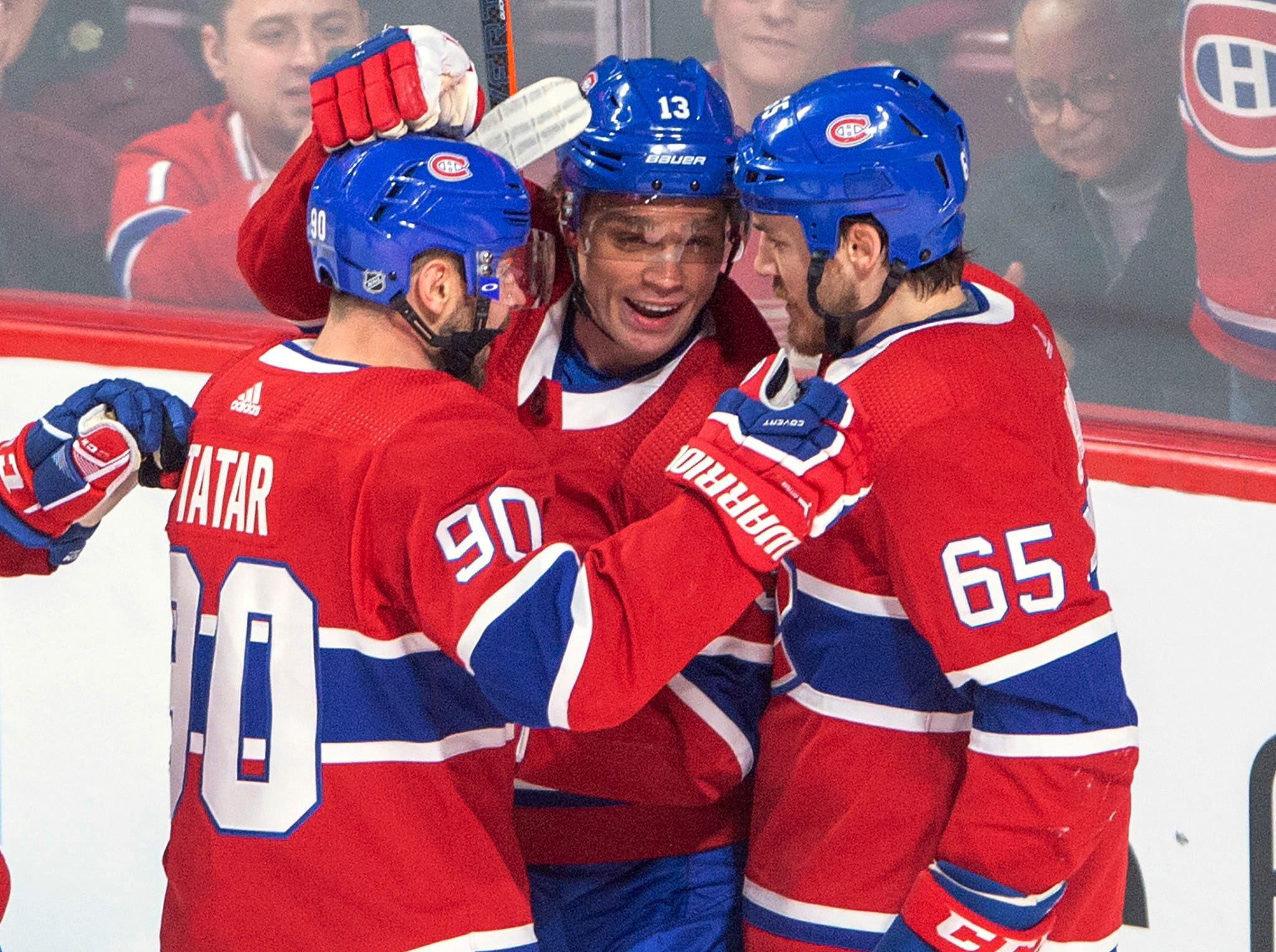 Montreal Canadiens center Max Domi (13) celebrates with teammates Tomas Tatar (90) and Andrew Shaw (65) after scoring against the Detroit Red Wings during the second period.