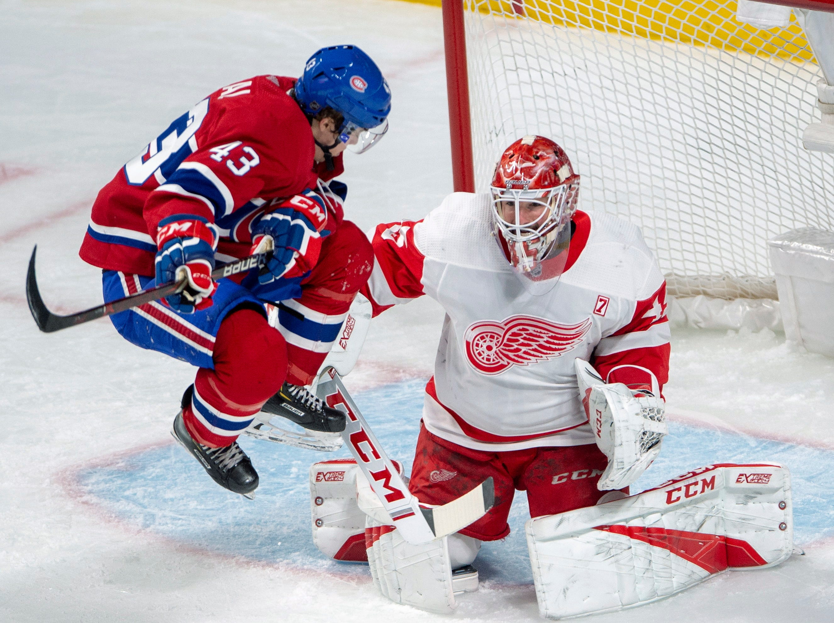 Montreal Canadiens centre Jordan Weal (43) jumps in front of Detroit Red Wings goaltender Jonathan Bernier (45) during the second period.