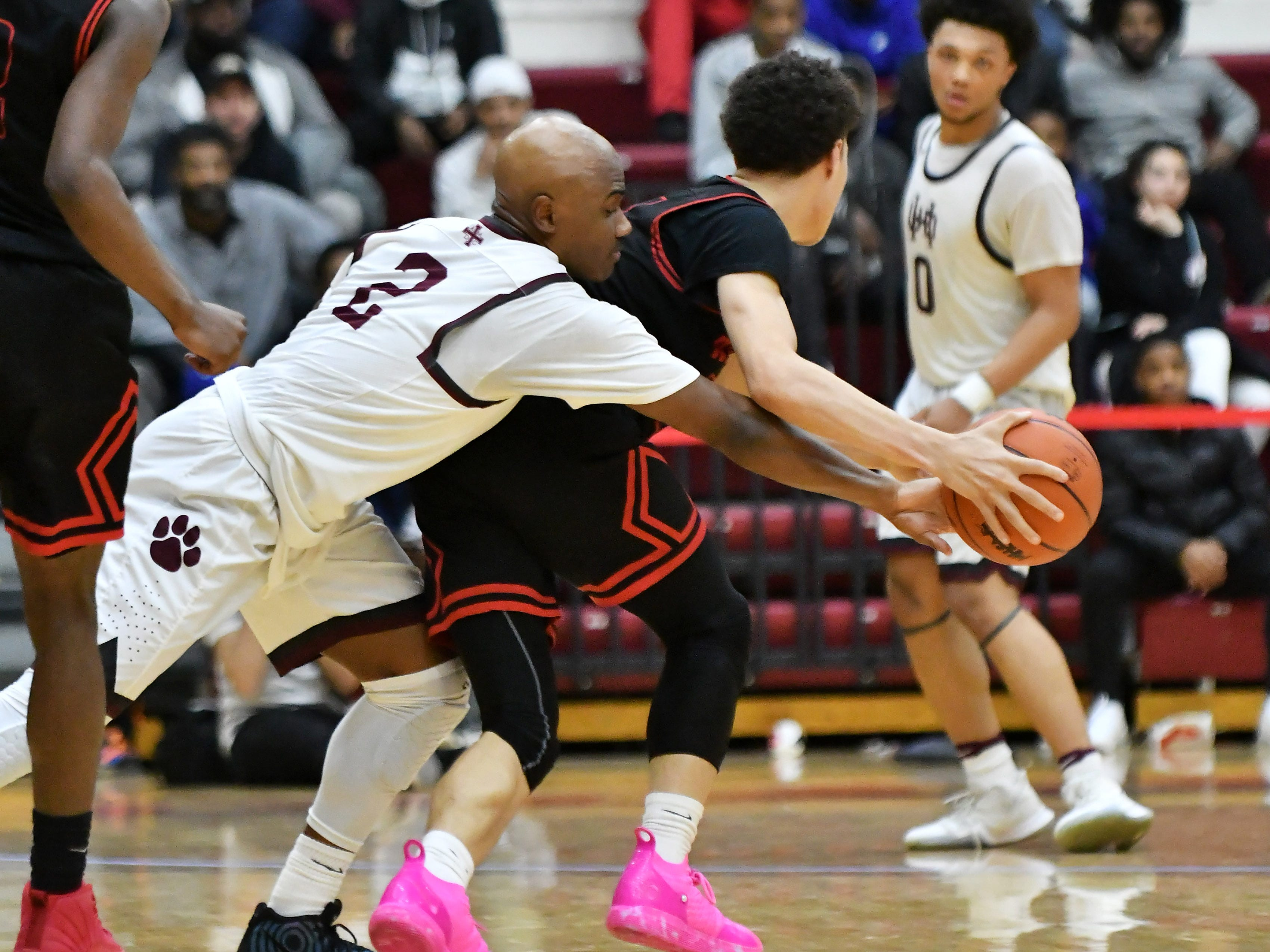 U-D Jesuit's Caleb Hunter (2) about to steal the ball from Roseville's Lazelle Judge in the second half.