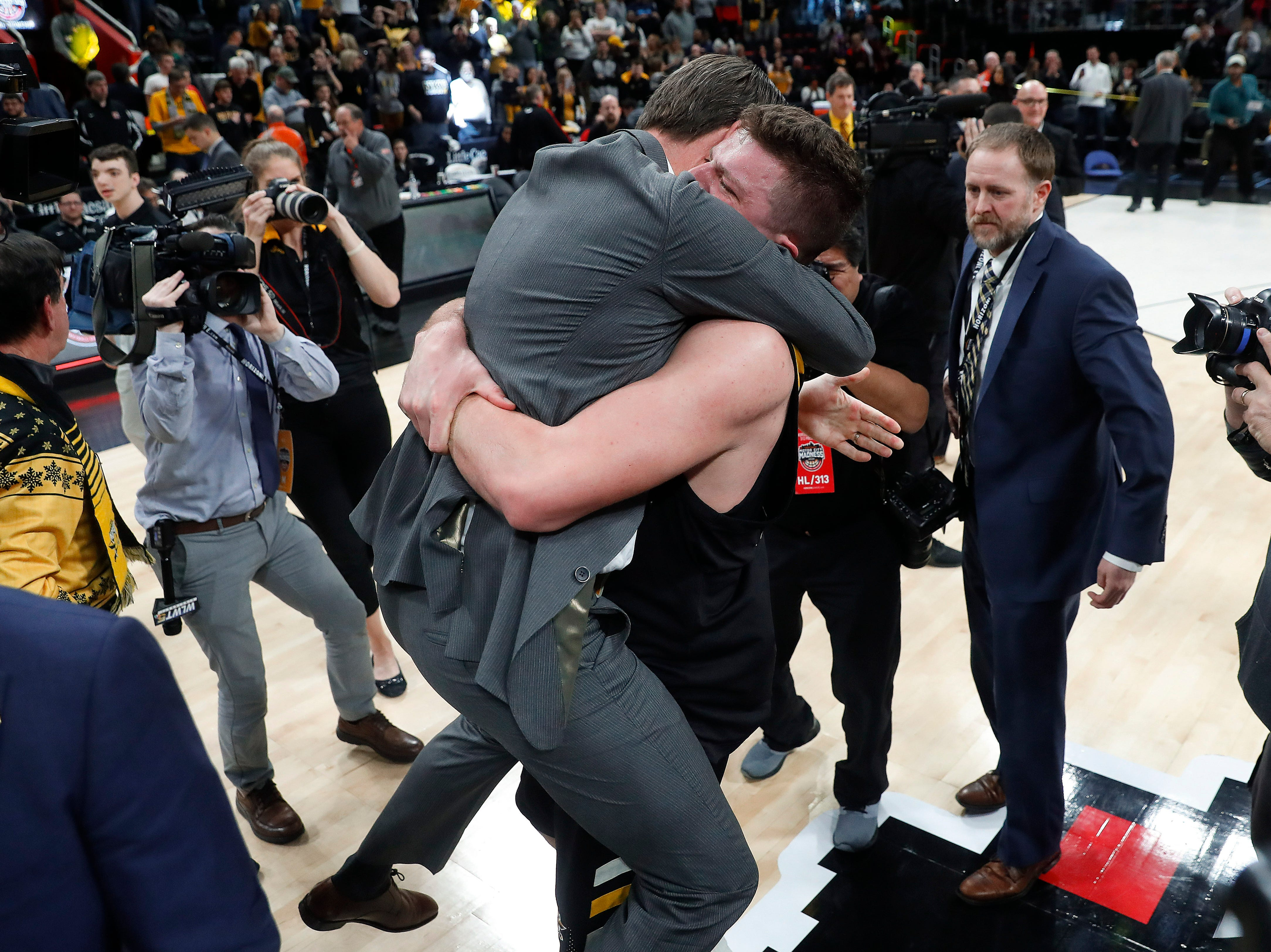 Northern Kentucky coach John Brannen and player Drew McDonald celebrate the team's 77-66 win against Wright State.