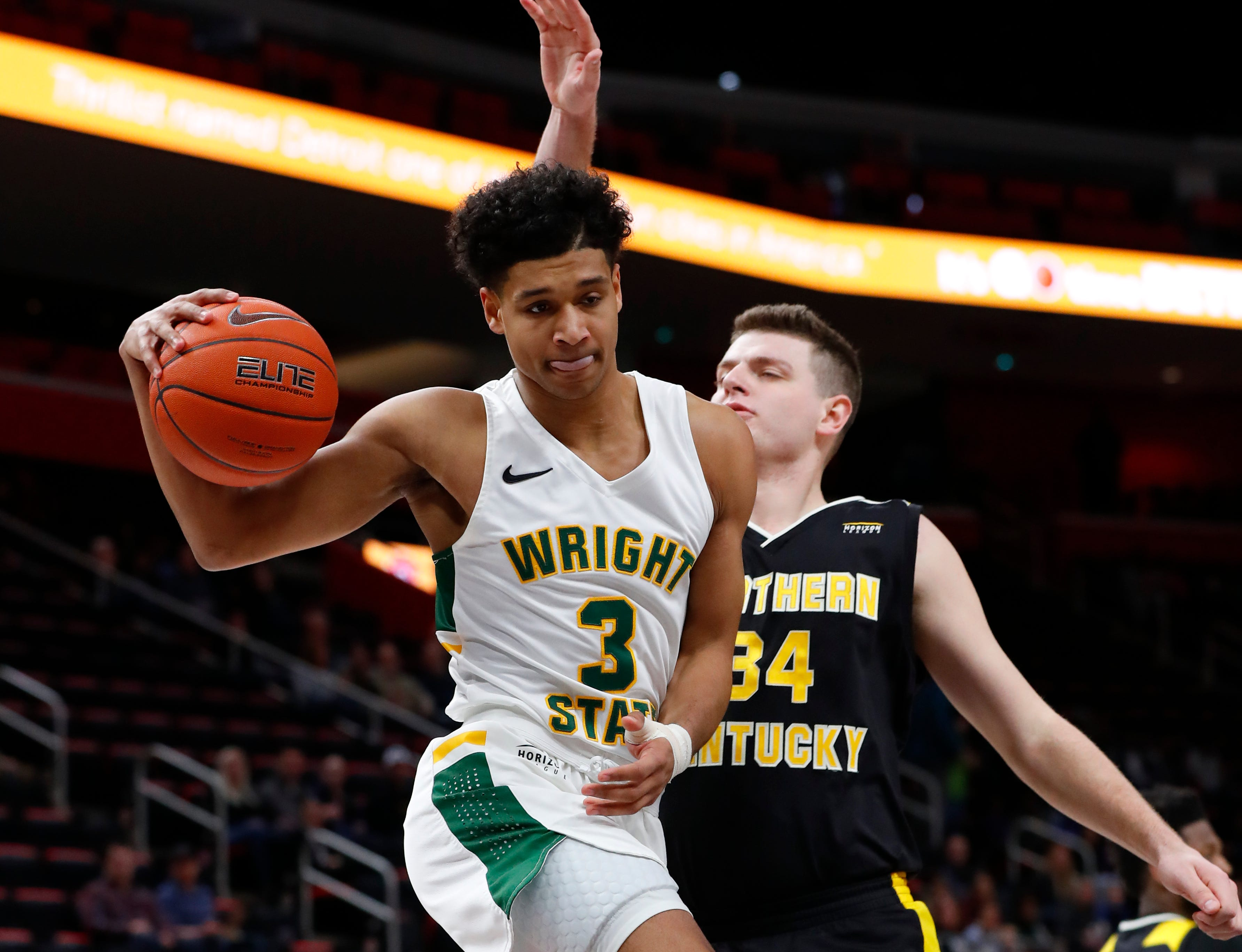 Wright State guard Mark Hughes (3) drives on Northern Kentucky forward Drew McDonald (34) during the first half.