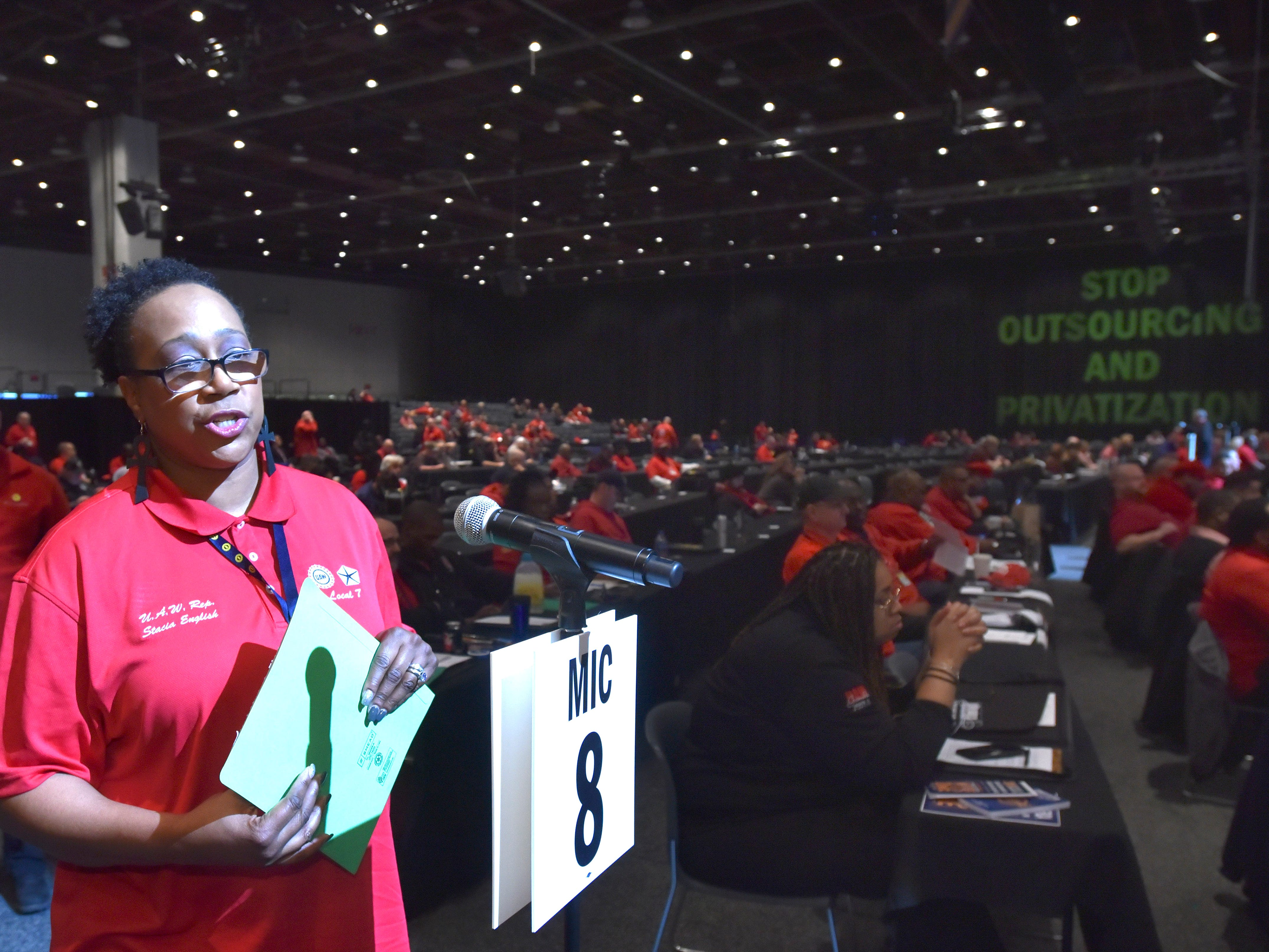 UAW Region 1 Local 7 trustee and delegate Stacia English of Clinton Twp. speaks in support of the New Technology and New Jobs resolution. She works at the FCA Jefferson North Assembly plant and is joined by others attending the 2019 Special Bargaining Convention at Cobo Center, Wednesday morning, March 13, 2019.