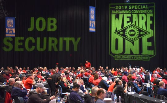 UAW delegates listen to speakers during the Special Convention on Collective Bargaining at Cobo Center.