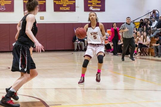 Elmira High graduate Zaria Thomas competes for the St. Thomas Aquinas College women's basketball team.